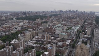 AX84_037 - 4K stock footage aerial video Flying by Central Park, seen from Morningside Heights, New York, New York