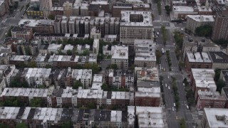 AX84_039 - 4K stock footage aerial video Flying over Harlem houses, tilt up revealing Central Park, New York, New York