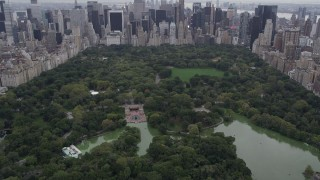 AX84_044 - 4K stock footage aerial video Flying over Central Park, revealing Midtown Manhattan, New York, New York