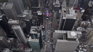 AX84_052 - 4K stock footage aerial video Flying over 7th Avenue, Times Square, Midtown Manhattan, New York, New York