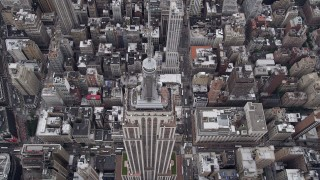 AX84_063 - Aerial stock footage of Flying over Empire State Building, Midtown Manhattan, New York, New York