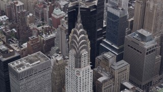 AX84_072 - 4K stock footage aerial video Approaching the top of the Chrysler Building, Midtown Manhattan, New York, New York