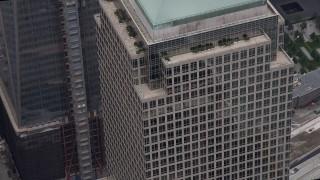 AX84_092 - 4K stock footage aerial video Flying by Three Financial Center, World Trade Center Memorial, New York, New York