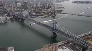 AX84_097 - 4K stock footage aerial video Flying by Manhattan Bridge, Brooklyn Bridge, East River, New York, New York