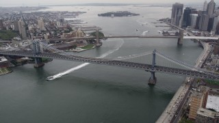 AX84_098 - 4K stock footage aerial video of Manhattan Bridge, Brooklyn Bridge, East River, Lower Manhattan, New York