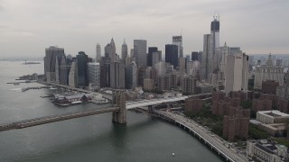 AX84_105 - 4K stock footage aerial video Approaching Brooklyn Bridge, Lower Manhattan skyline, New York, New York