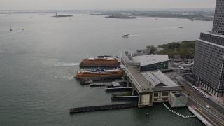 AX84_109 - 4K stock footage aerial video Flying by Staten Island Ferries, Lower Manhattan, New York, New York