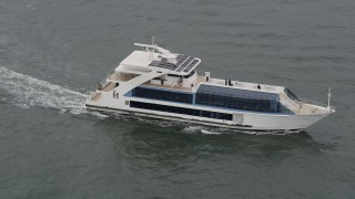 AX84_111 - 4K stock footage aerial video Flying by a ferry Sailing the Hudson River, New York, New York