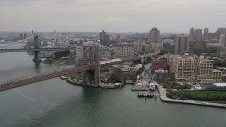 AX84_117 - 4K stock footage aerial video Approaching Brooklyn Bridge, East River, Brooklyn buildings, New York, New York