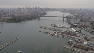 AX84_121 - 4K stock footage aerial video Flying by Williamsburg Bridge, Midtown Manhattan skyline, New York, New York