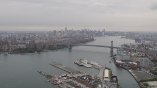 AX84_122 - 4K stock footage aerial video Flying by Williamsburg Bridge, Midtown Manhattan skyline, New York, New York