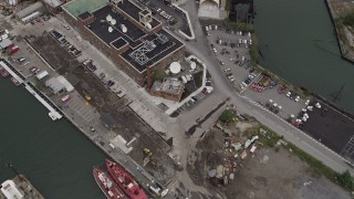 AX84_123 - 4K stock footage aerial video Flying over Brooklyn Navy Yard piers, reveal Williamsburg Bridge, New York, New York