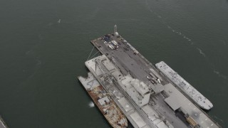 AX84_124 - 4K stock footage aerial video of Brooklyn Navy Yard piers, Williamsburg Bridge, Midtown Manhattan, New York
