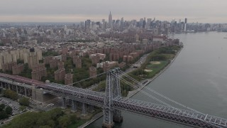 AX84_126 - Aerial stock footage of 4K Aerial Video Approaching Lower East Side housing, New York, New York