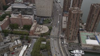 AX84_134 - Aerial stock footage of 4K Aerial Video Flying over Kips Bay, revealing East River, New York, New York