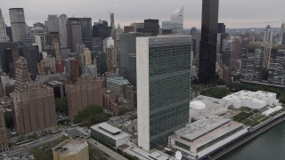 AX84_137 - Aerial stock footage of 4K Aerial Video Flying by United Nations, Midtown Manhattan, New York, New York