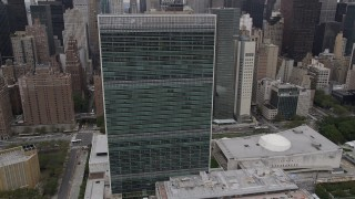 AX84_138 - Aerial stock footage of 4K Aerial Video Flying by United Nations, Midtown Manhattan, New York, New York