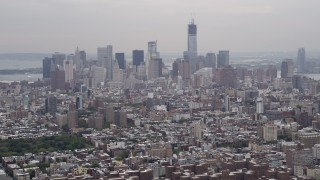 AX84_148 - Aerial stock footage of 4K Aerial Video Flying by Lower Manhattan, seen from Midtown, New York, New York