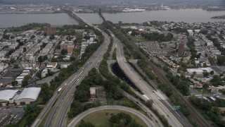 AX84_170 - Aerial stock footage of 4K Aerial Video Flying over New Jersey Turnpike, Jersey City, New Jersey