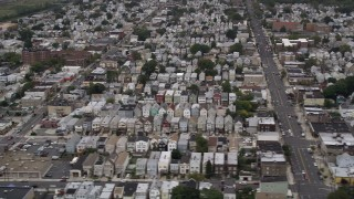 AX84_171 - Aerial stock footage of 4K Aerial Video Flying by residential neighborhoods, Bayonne, New Jersey