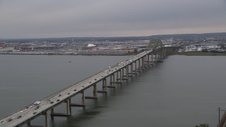 AX84_172 - Aerial stock footage of 4K Aerial Video Flying by Newark Bay Bridge, reveal Lehigh Valley Railroad Bridge, Newark, New Jersey