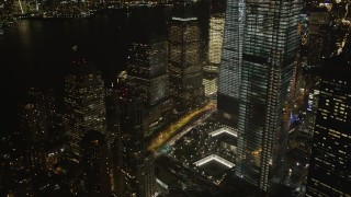 AX85_015 - 4K stock footage aerial video Tilting down on World Trade Center Memorial, New York, New York, night