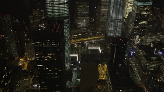 AX85_016 - 4K stock footage aerial video of World Trade Center Memorial, World Trade Center, New York, New York, night