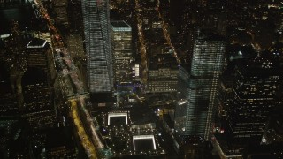 AX85_027 - 4K stock footage aerial video of World Trade Center Memorial, Lower Manhattan, New York, New York, night
