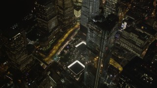 AX85_028 - 4K stock footage aerial video of World Trade Center Memorial, Lower Manhattan, New York, New York, night