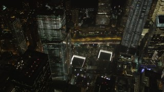 AX85_029 - 4K stock footage aerial video of the World Trade Center Memorial, Lower Manhattan, New York, New York, night