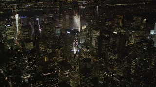 AX85_062 - 4K stock footage aerial video Approaching Chrysler Building, Midtown Manhattan, New York, New York, night