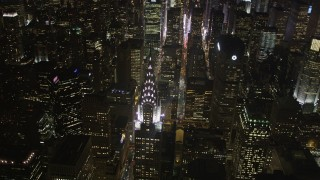 AX85_068 - 4K stock footage aerial video Flying by Chrysler Building, Midtown Manhattan, New York, New York, night