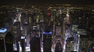 AX85_075 - 4K stock footage aerial video Times Square skyscrapers, Midtown Manhattan, New York, New York, night