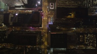 AX85_084 - 4K stock footage aerial video Bird's eye view following Avenue of the Americas, New York, New York, night