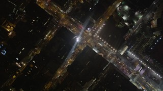 AX85_088 - 4K stock footage aerial video Bird's eye view orbiting Chelsea streets, New York, New York, night