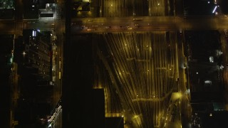 AX85_090 - 4K stock footage aerial video West Side Yard, Chelsea streets, New York, New York, night
