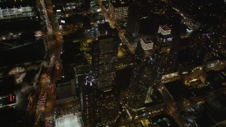 AX85_091 - 4K stock footage aerial video Flying over skyscrapers, Chelsea, New York, New York, night