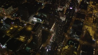 AX85_092 - 4K stock footage aerial video Flying by skyscrapers, Chelsea, New York, New York, night