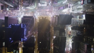 AX85_095 - 4K stock footage aerial video Bird's eye view over Times Square, Midtown Manhattan, New York, night
