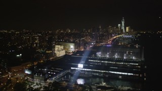 AX85_114 - 4K stock footage aerial video Flying over piers along Hudson River, Chelsea, New York, New York, night