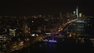 AX85_115 - 4K stock footage aerial video Fly over piers, Hudson River, Chelsea, Lower Manhattan, New York, New York, night