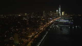 AX85_116 - 4K stock footage aerial video Fly over piers, Hudson River, Chelsea, Lower Manhattan, New York, New York, night