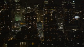 AX85_123 - Aerial stock footage of Flying by Lower Manhattan skyscrapers, New York, New York, night