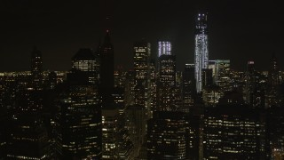 AX85_130 - 4K stock footage aerial video Fly by One World Trade Center, Lower Manhattan, New York, New York, night