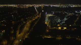 AX85_139 - 4K stock footage aerial video Flying over New Jersey Turnpike, Newark Bay Bridge, Newark, New Jersey, night