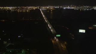 AX85_140 - 4K stock footage aerial video Flying over Newark Bay Bridge, Newark, New Jersey, night