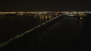 AX85_141 - 4K stock footage aerial video Flying by the Newark Bay Bridge, Newark, New Jersey, night