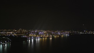 AX85_142 - 4K stock footage aerial video Flying by an oil refinery on the shore, Newark Bay, Newark, New Jersey, night