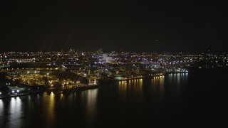 AX85_143 - 4K stock footage aerial video of flying by an oil refinery, Newark Bay, Newark, New Jersey, night