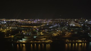 AX85_144 - 4K stock footage aerial video Flying by an oil refinery, Newark Bay, Newark, New Jersey, night